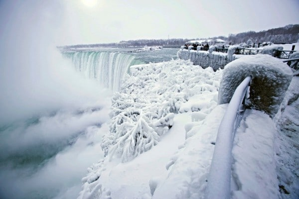 b Niagara Falls is currently coated in ice and it's absolutely jaw-dropping